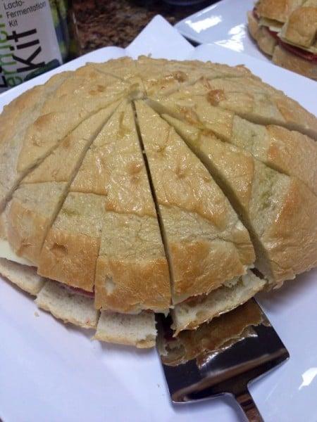 Layered Muffato sandwich with slaw